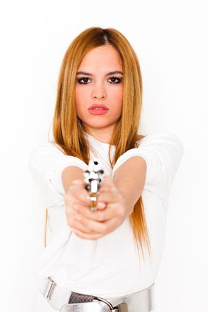 attractive young blonde woman with a chrome gun on white background, selective focus on face
