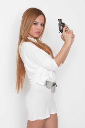 attractive young blonde woman with a chrome gun on white background   Stock Photo