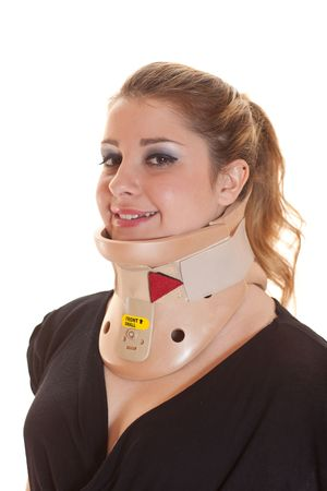 Blonde woman with decollete wearing neck protector, smiling to the camera