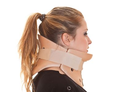 Blonde woman wearing neck protector, side view