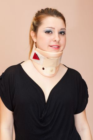 Blonde woman with decollete wearing neck protector, smiling to the camera, front view Stock Photo - 7155969