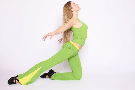Young blonde woman doing stretching exercise, white background photo