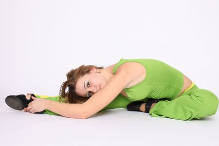 Young blonde woman doing stretching exercise, white background Stock Photo