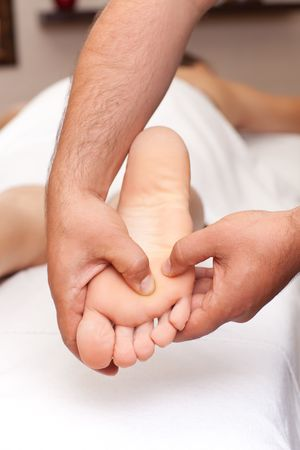 hand towel: Foot receiving a massage in a spa setting (close up)  Stock Photo