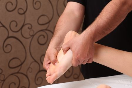 Foot receiving a massage in a spa setting (close up)  Stock Photo - 6834173