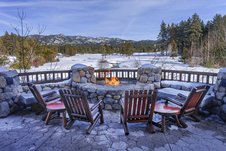 south lake tahoe: Chairs and fire pit overlooking the Edgewood GC in Lake Tahoe. Stock Photo