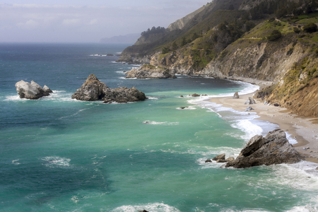 This image was taken at the McWay Falls overlook located near Big Sur. This image is looking North, about 40 miles from Carmel.