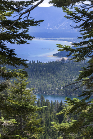 high sierra: An image looking down at South Lake Tahoe from a local trail. The smaller lake below is Cascade lake, which is private. Stock Photo