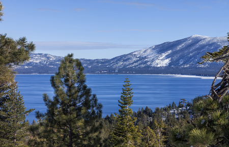This is a winter image taken near Emerald Bay, overlooking Southern part of Lake Tahoe. In the distance you can see the Casinos and Heavenly Valley. Stock Photo
