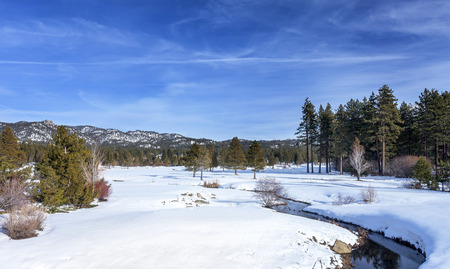 high sierra: A winter scene overlooking a meadow and creek in Lake Tahoe, California. This image is looking East towards Nevada.