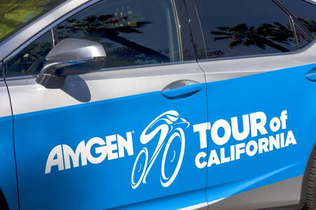 Amgen, Tour of California, SACRAMENTO, CA –May 12, 2019: Amgen, Tour of California race 2019 silver and blue pace car and tour logo.