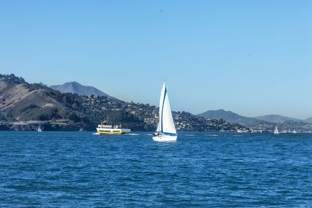 Sailing San Francisco Bay, SAN FRANCISCO, CA - DECEMBER 10, 2017: The image is of a sail boat sailing in the San Francisco Bay near the Marina District Harbor.