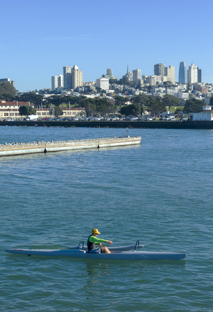 Kayaking San Francisco Bay, SAN FRANCISCO, CA - DECEMBER 10, 2017: The image is of a small kayak taking a trip in front San Francisco�s Marina district. Sailing is a popular activity with San Francisco tourists and residents sailing boats of all sizes.  Editorial