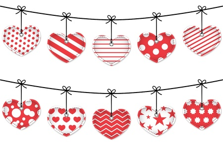Valentine red textured hearts tied with bows hanging on white background.
