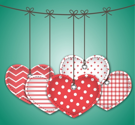 Valentine red textured hearts tied with bows hanging on green background. Stock Vector - 17310336