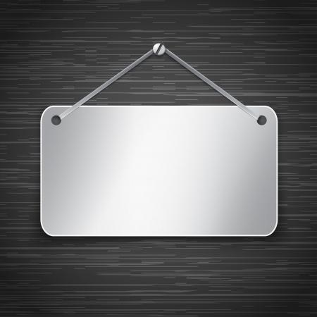 Blank metallic tablet hanging on dark brushed metallic wall.  illustration