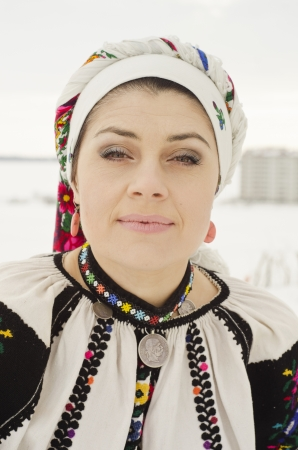 Woman in traditional ukrainian cloth on snow