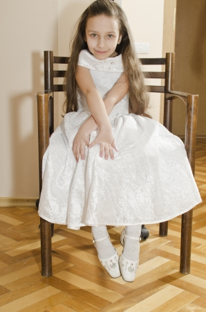Young pretty girl is sitting in chair in hairdresser photo