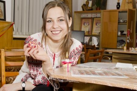 wickerwork: Nice girl is holding Easter Egg in hand Stock Photo