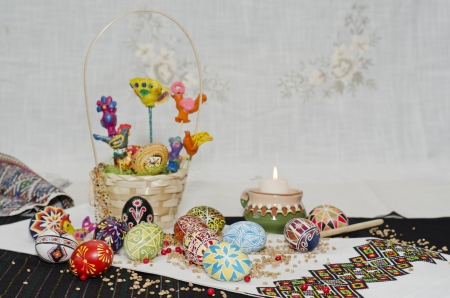 Easter eggs on white and black weaving background photo