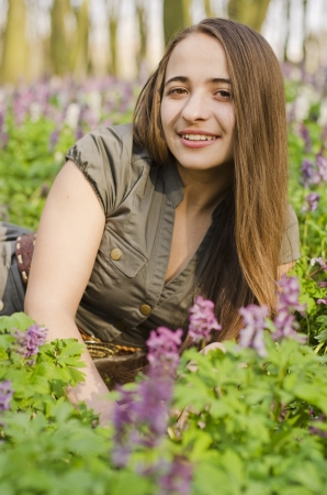 corydalis: Portrait of beautiful smiling girl in corydalis