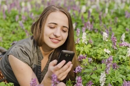 corydalis: Girl in corydalis is looking at mobile