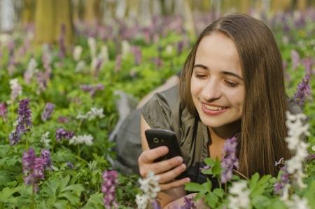 corydalis: beautiful girl is looking at mobile in corydalis