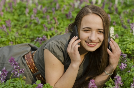 corydalis: beautiful girl is lspeaking on  mobile in corydalis Stock Photo