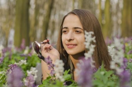 corydalis: portrait of beautiful girl with sun glasses in corydalis Stock Photo