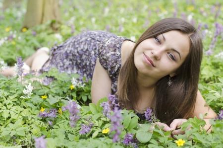 corydalis: Portrait of  beautiful girl  among corydalis