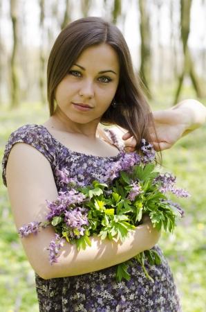corydalis: portrait of beautiful girl with corydalis