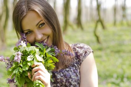 corydalis: portrait of beautiful smiling girl with corydalis