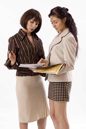 Two business women working photo