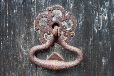 Old rusty door handle Stock Photo
