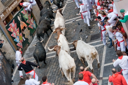 PAMPLONA, SPAIN -JULY 8  Unidentified men running from the bulls in the street Estafeta to the San Fermin festival in Pamplona July 8 2011  Festival annual