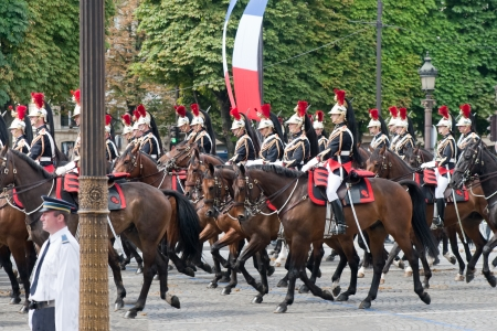 elysees: PARIS - JULY 14  Cavalry at a military parade in the Republic Day on the Champs Elysees in Paris July 14, 2011  Bastille Day