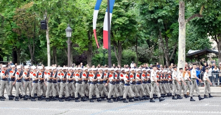 champs elysees: PARIS - JULY 14: Foreign Legion at a military parade in the Republic Day (Bastille Day) on the Champs Elysees in Paris, France on July 14, 2012. Editorial