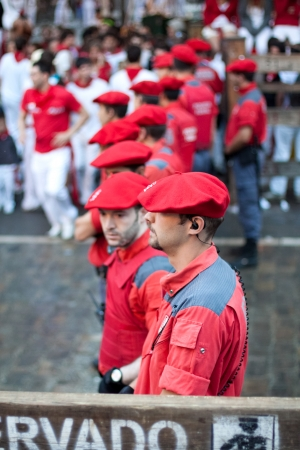 carabineer: PAMPLONA, SPAIN -JULY 9: Police officers working at the festival of San Fermin. Pamplona, Navarra, Spain 9 July 2011 in Pamplona Spain. Editorial