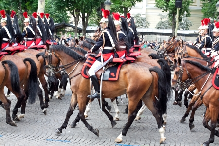 nit: PARIS - JULY 14: Cavalry at a military parade in the Republic Day (Bastille Day) on the Champs Elysees in Paris, France on July 14, 2012. Editorial