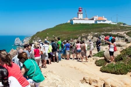 roca: CAPE CABO DA ROCA, PORTUGAL - JULY 30  People are watching at rescue operation at Cape Cabo da Roca, Portugal, July 30, 2013 Editorial