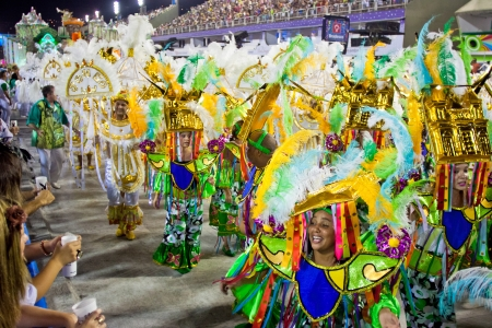 RIO DE JANEIRO - FEBRUARY 10: A womans and man in costume dancing and singing on carnival at Sambodromo in Rio de Janeiro February 10, 2013, Brazil. The Rio Carnival is biggest carnival in world.