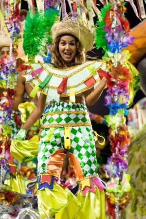 RIO DE JANEIRO - FEBRUARY 10: A woman in costume dancing on carnival at Sambodromo in Rio de Janeiro February 10, 2013, Brazil. The Rio Carnival is biggest carnival in world.  Editorial