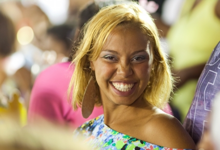 RIO DE JANEIRO - FEBRUARY 10: A woman in the stands laughing on carnival Sambodromo in Rio de Janeiro February 10, 2013, Brazil. The Rio Carnival is biggest carnival in world. Editorial