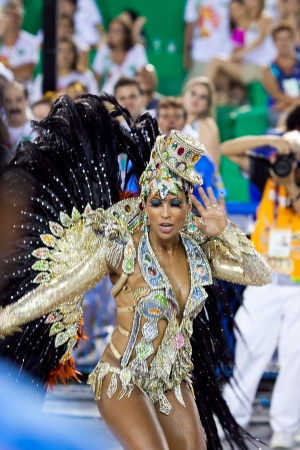 RIO DE JANEIRO - FEBRUARY 11: Samba dancer in costume singing and dancing on carnival at Sambodromo in Rio de Janeiro February 11, 2013, Brazil. The Rio Carnival is biggest carnival in world.