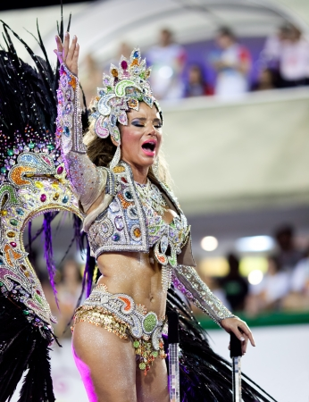 RIO DE JANEIRO - FEBRUARY 11: A woman in costume dancing and singing on carnival at Sambodromo in Rio de Janeiro February 11, 2013, Brazil. The Rio Carnival is biggest carnival in world.