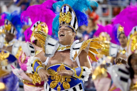 RIO DE JANEIRO - FEBRUARY 11: A man in costume singing and dancing on carnival at Sambodromo in Rio de Janeiro February 11, 2013, Brazil. The Rio Carnival is biggest carnival in world. Editorial