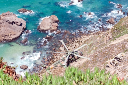 roca: CAPE CABO DA ROCA, PORTUGAL - JULY 30: Military helicopter takes part in rescue operation at Cape Cabo da Roca, Portugal, July 30, 2013 Editorial