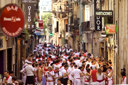 PAMPLONA, SPAIN -JULY 8: People on street  during San Fermin festival in Pamplona, Spain on July 8, 2013.