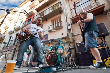 hemingway: PAMPLONA, SPAIN - JULY 8: The musicians play on street during San Fermin festival in Pamplona, Spain on July 8, 2013.
