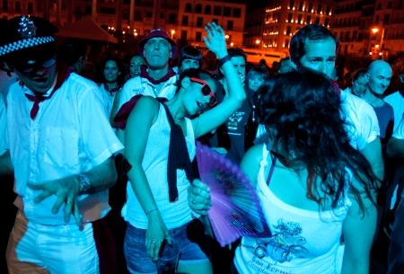 hemingway: PAMPLONA, SPAIN - JULY 9: People dancing in square Castillo at San Fermin festival. Pamplona, Navarra, Spain July 9, 2013. Editorial